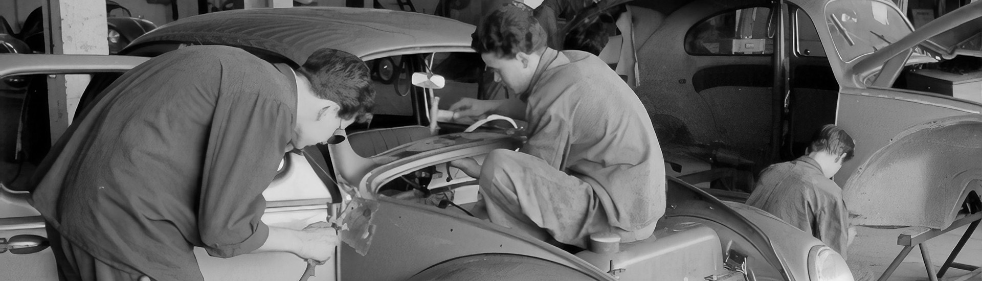 men-looking-at-working-on-car-fixing